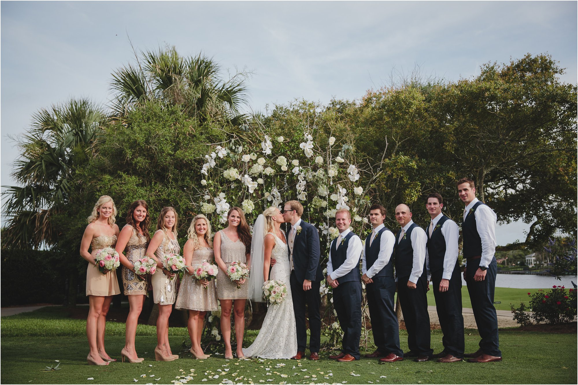 wedding party at ceremony alter on spa lawn at ponte vedra inn and club