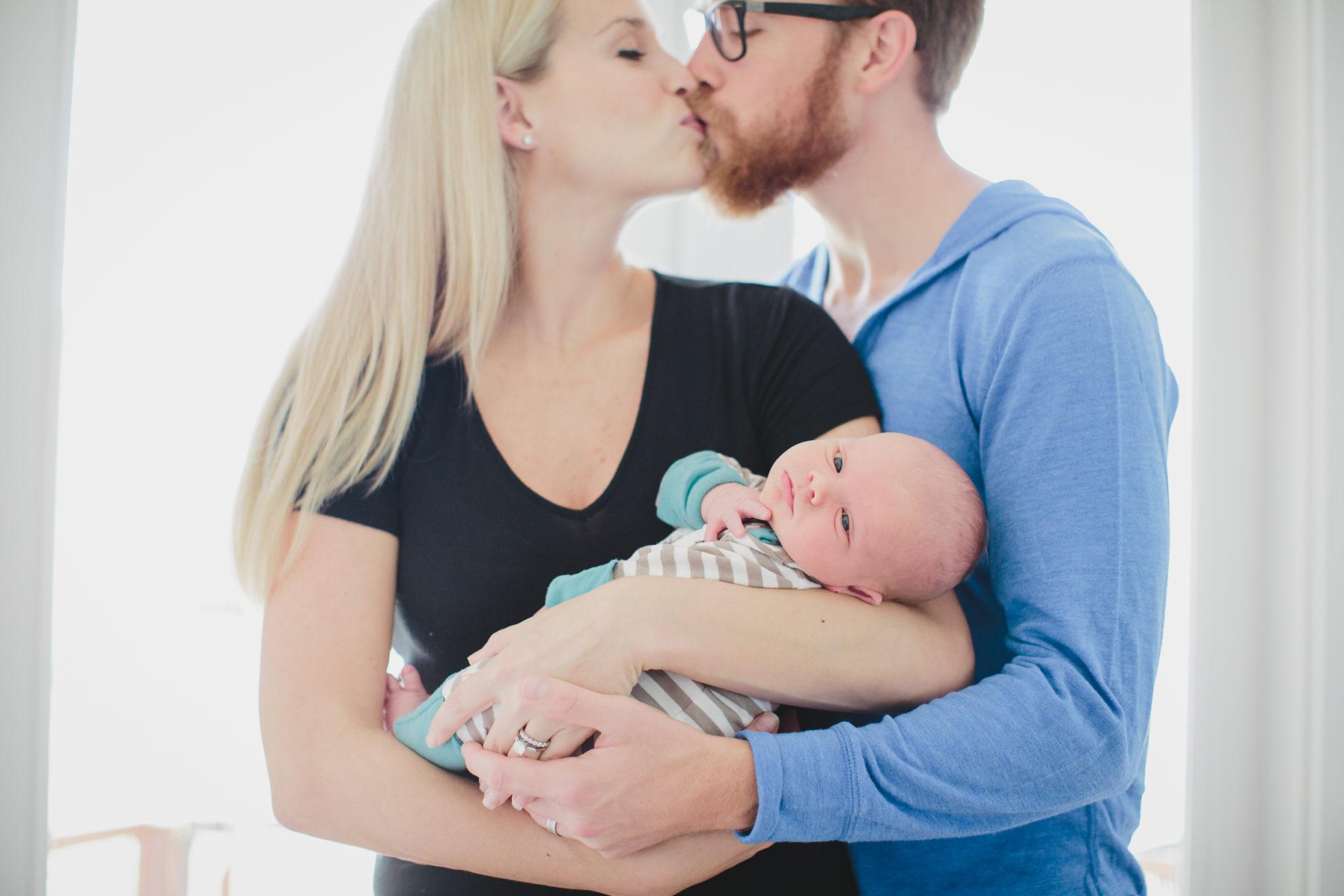 parents holding their newborn boy