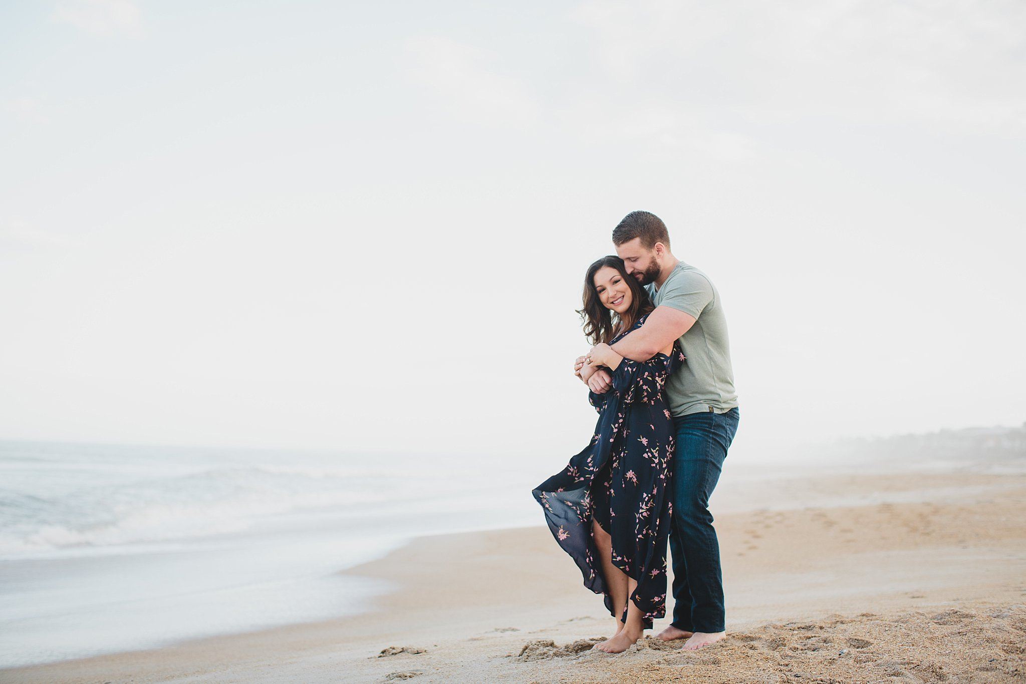 couple hugging and standing on ponte vedra beach