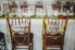 bride and grooms chairs with signs