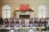 table and fireplace decorated at ribault club wedding reception