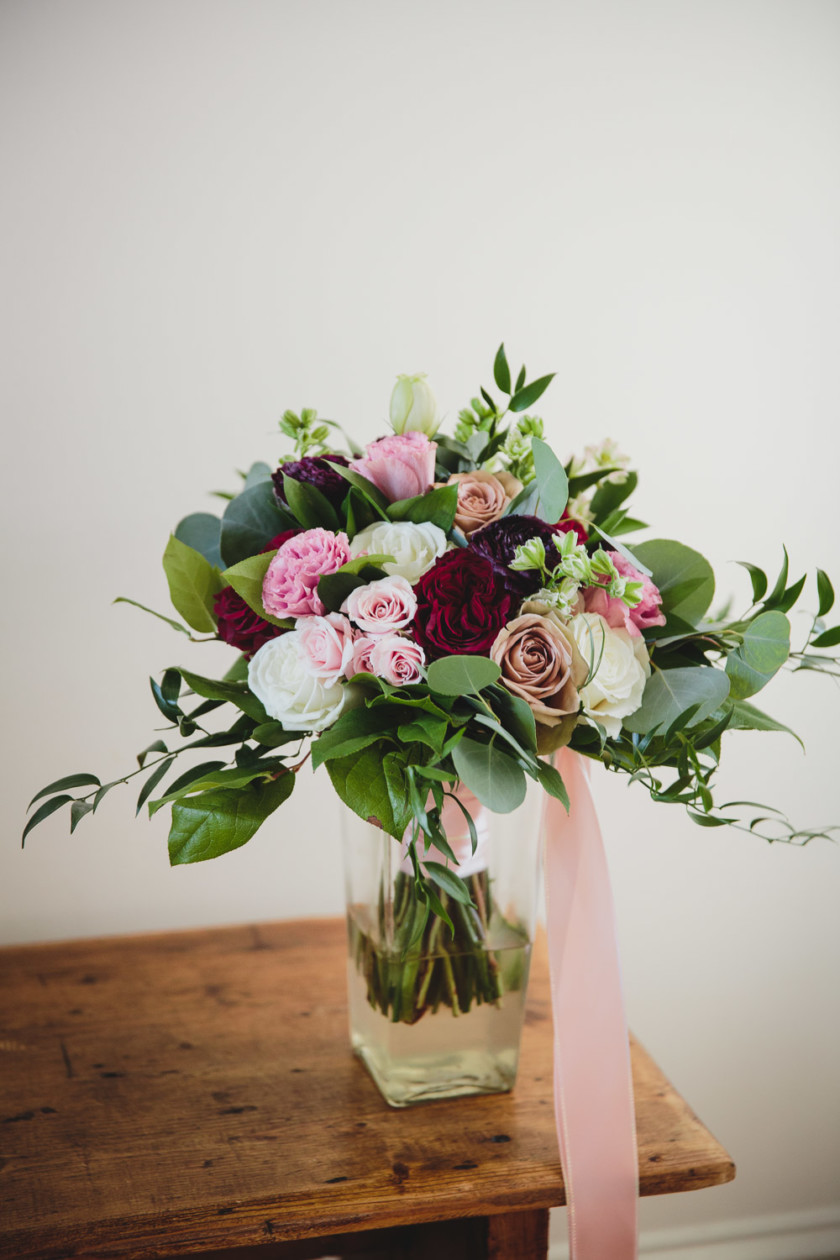 wedding bouquet with white, pink and burgundy florals
