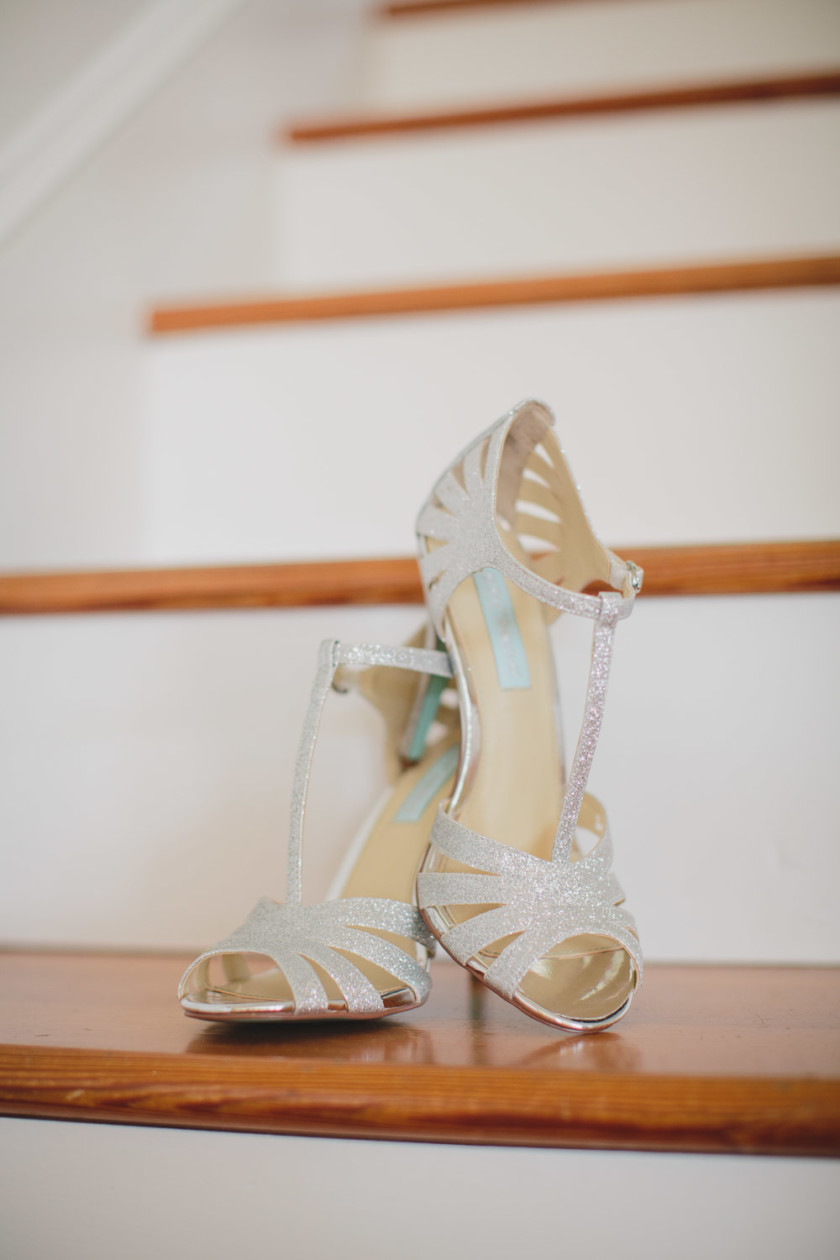 bridal shoes set up in wooden stairs