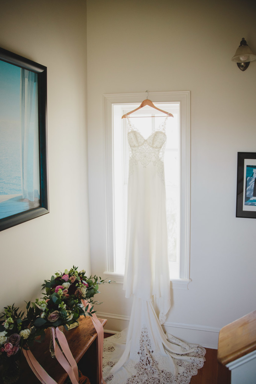 wedding gown hanging in window