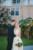 groom hugging onto bride in garden