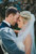 groom and bride with foreheads touching and veil flowing on them