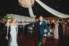 groom spinning bride on grand ballroom dance floor