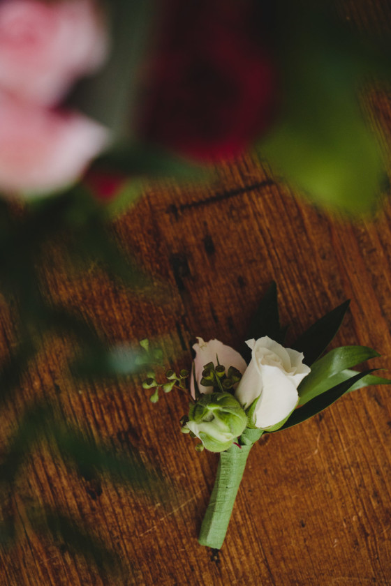 groom boutonniere white rose