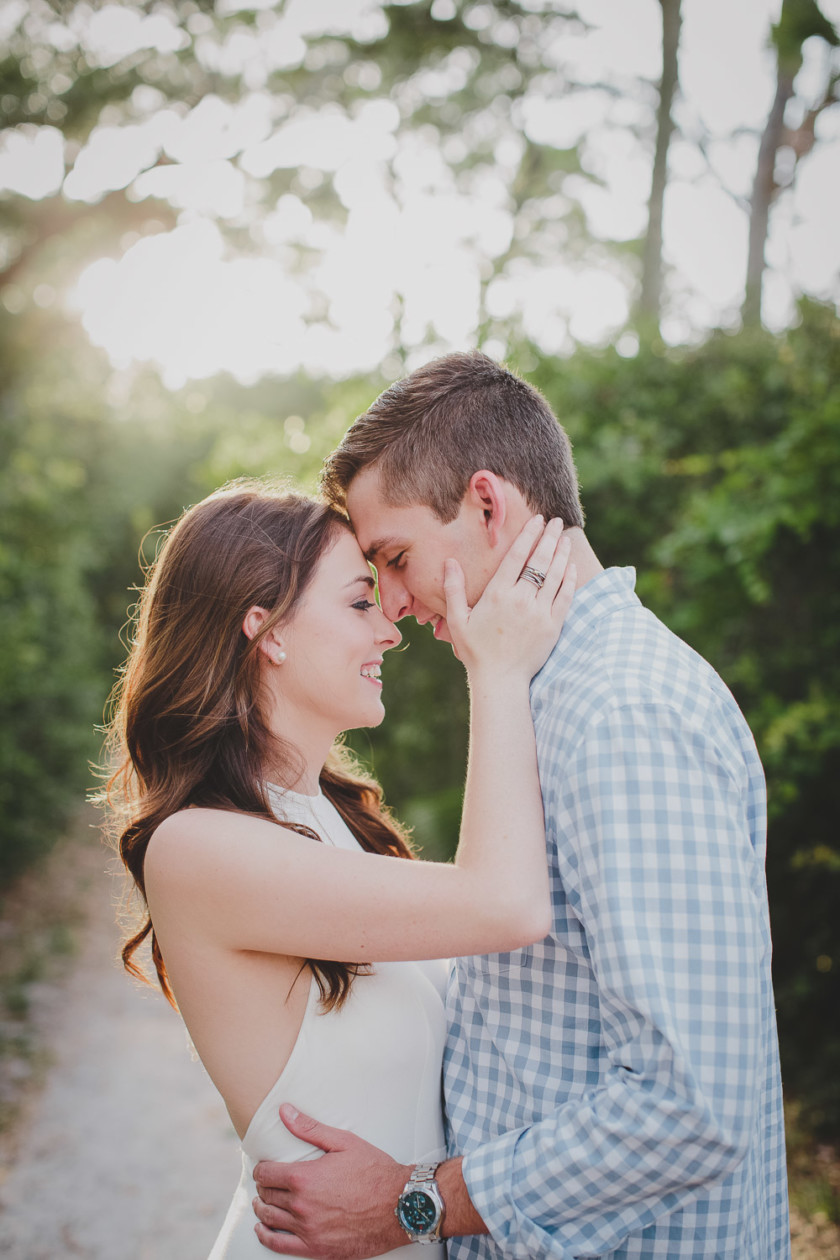 couple hugging on dirt path