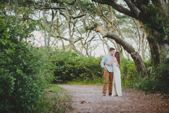 couple kissing during their engagement session at big talbot island