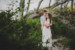 man hugging woman from behind during engagement session at big talbot island