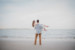 man holding woman at beach