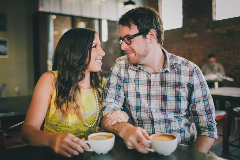 couple having coffee and looking at each other
