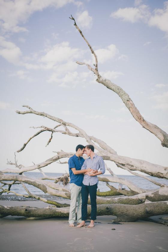 two men hugging at big talbot island beach