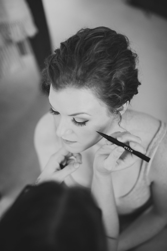 bride getting eye liner professional applied