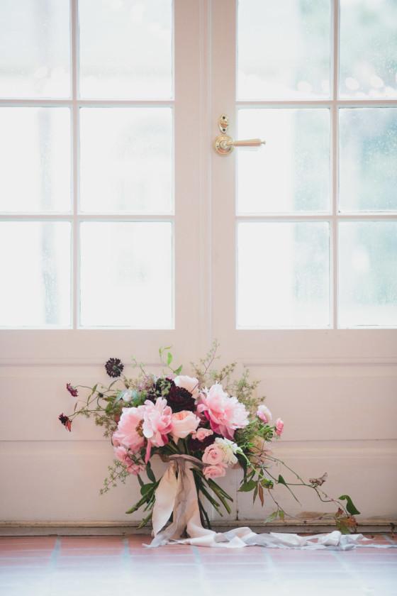 wedding bouquet in front of doors