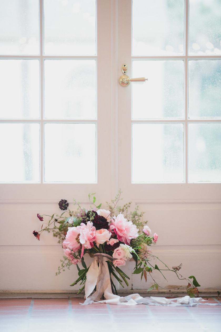 wedding bouquet in front of doors
