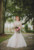 bride standing in front of ribault club holding bouquet