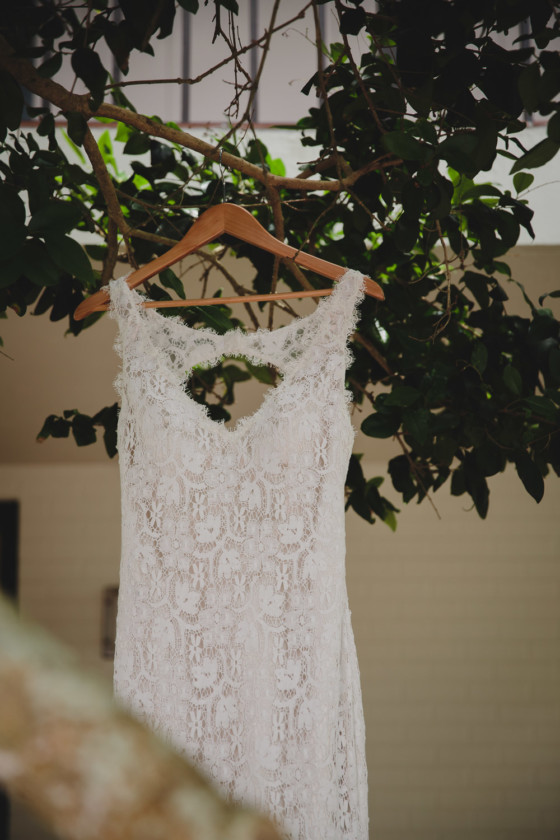 bride's gown hanging from tree