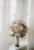 bridal bouquet set up in window