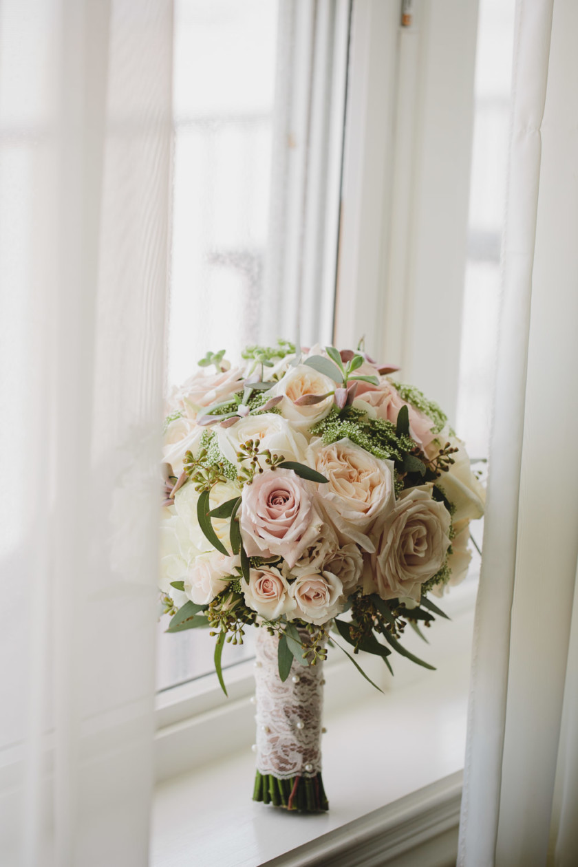bridal bouquet set up in window
