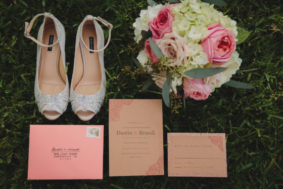 wedding invitation, bridal shoes and wedding bouquet