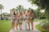 bride and bridesmaids standing together on path at ponte vedra inn and club