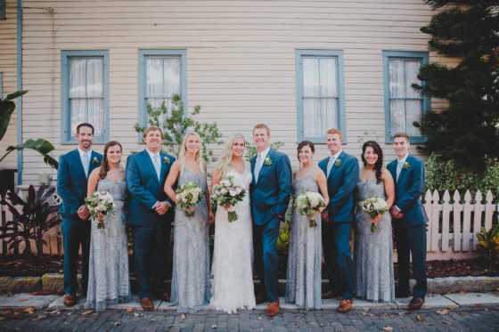 wedding party posed in front of house in st. augustine