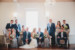 wedding party on chairs and sofas or standing