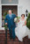 bride and her father walking down stairs to aisle