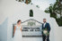 bride and groom standing in front of marquee at casa marina