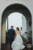 bride and groom walking through archway