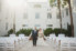 bride and groom standing in courtyard of wedding ceremony area at casa marina hotel