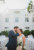 bride and groom kissing in courtyard of jacksonville beach hotel