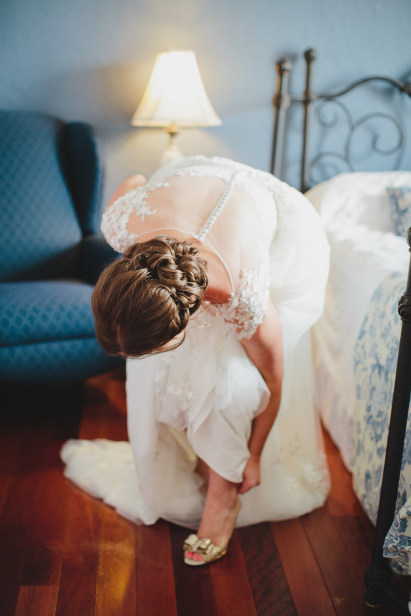 bride putting on heel getting ready for ceremony