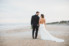 bride and groom walking away on ponte vedra beach