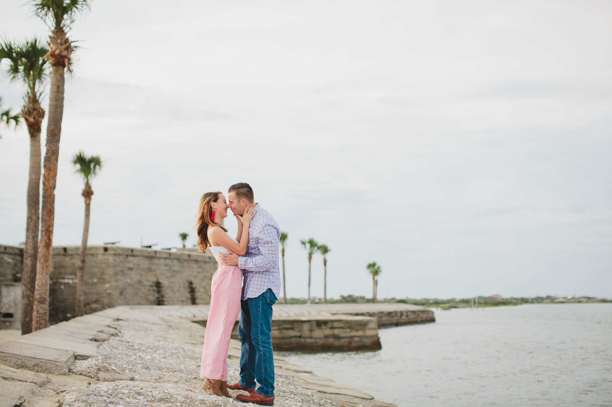 couple standing in Castillo de San Marcos