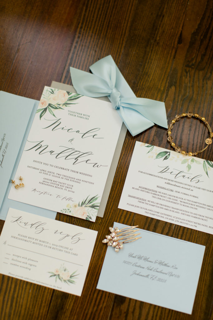 wedding invitation suite of light blue and white