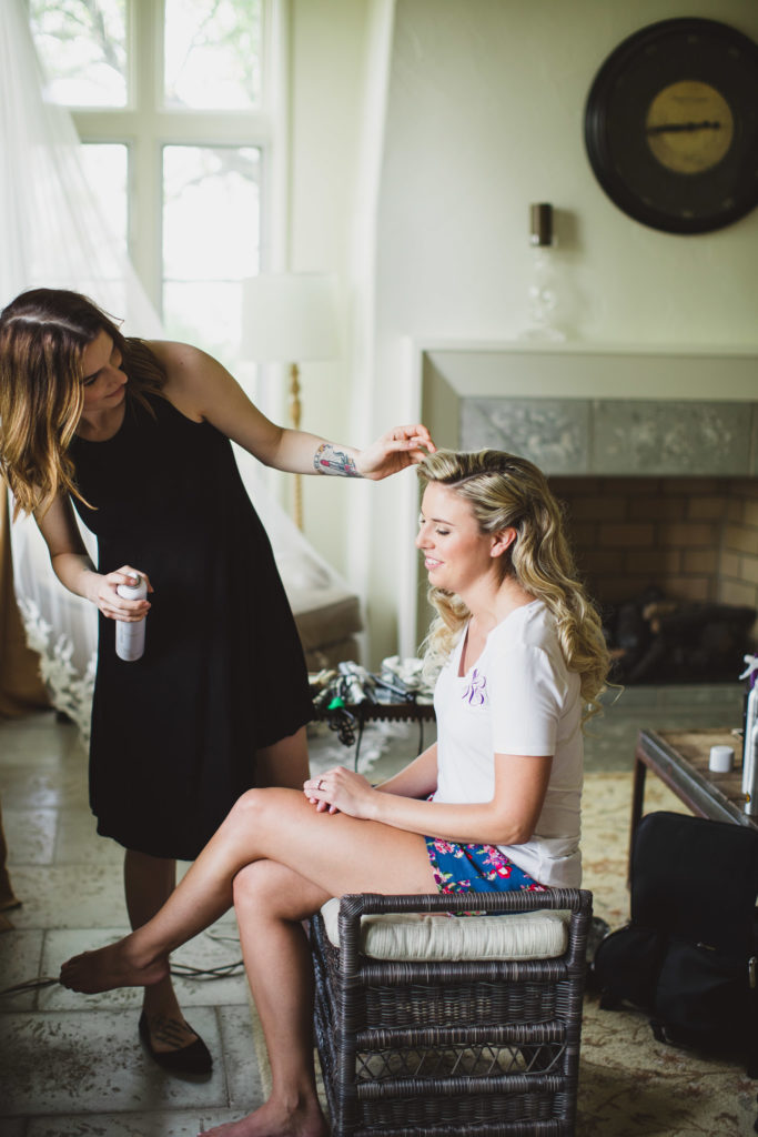 bride getting hair done