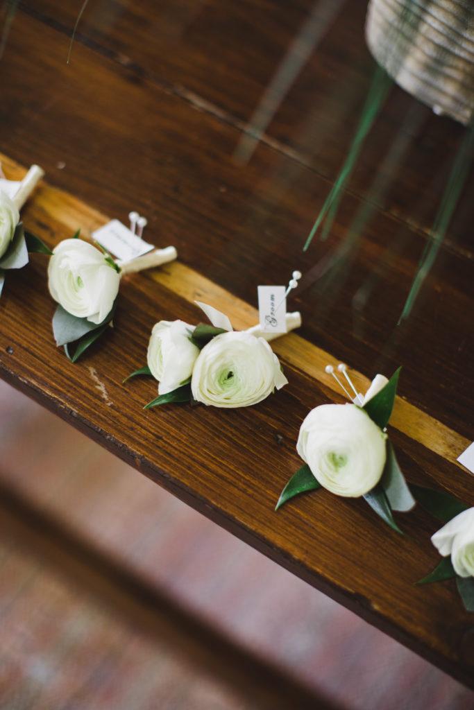 groom and groomsmen boutonnieres of ranunculus