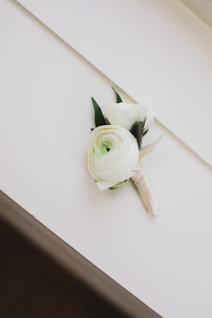 white ranunculus groom boutonniere