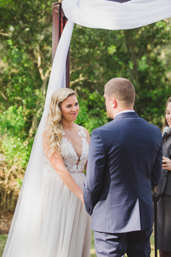 bride looking at groom during outside ceremony