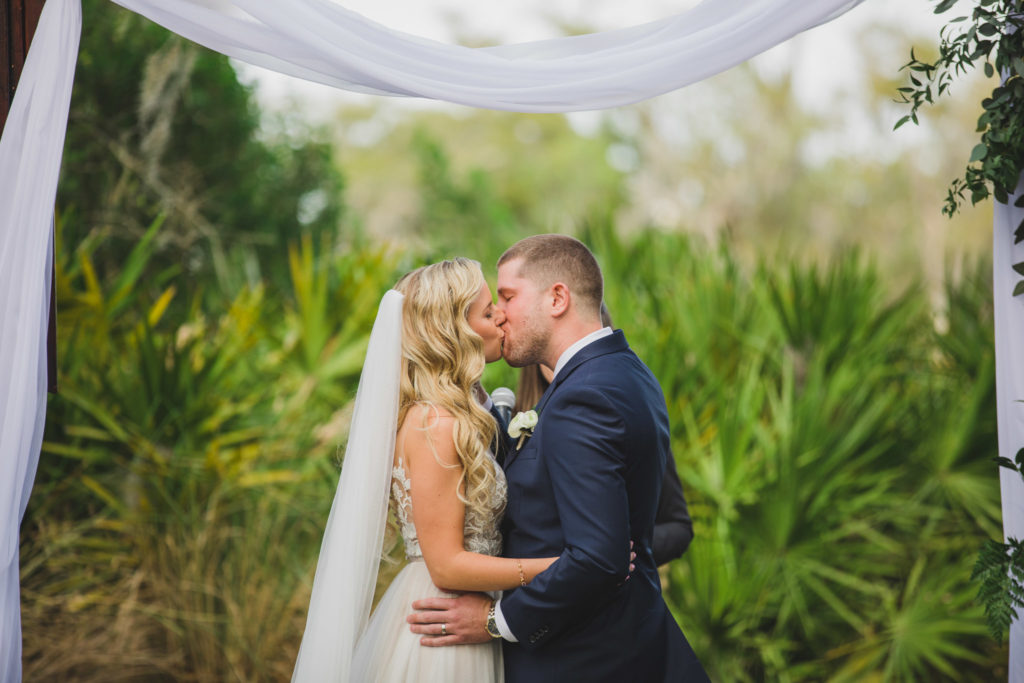 first kiss at outdoors ceremony