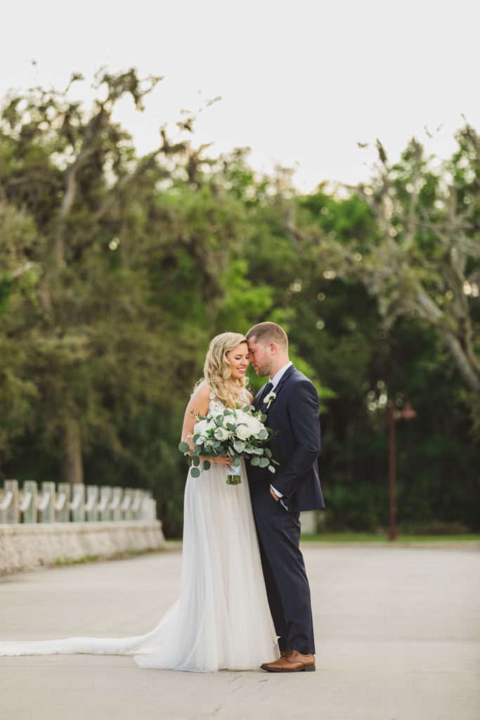 groom and bride hugging