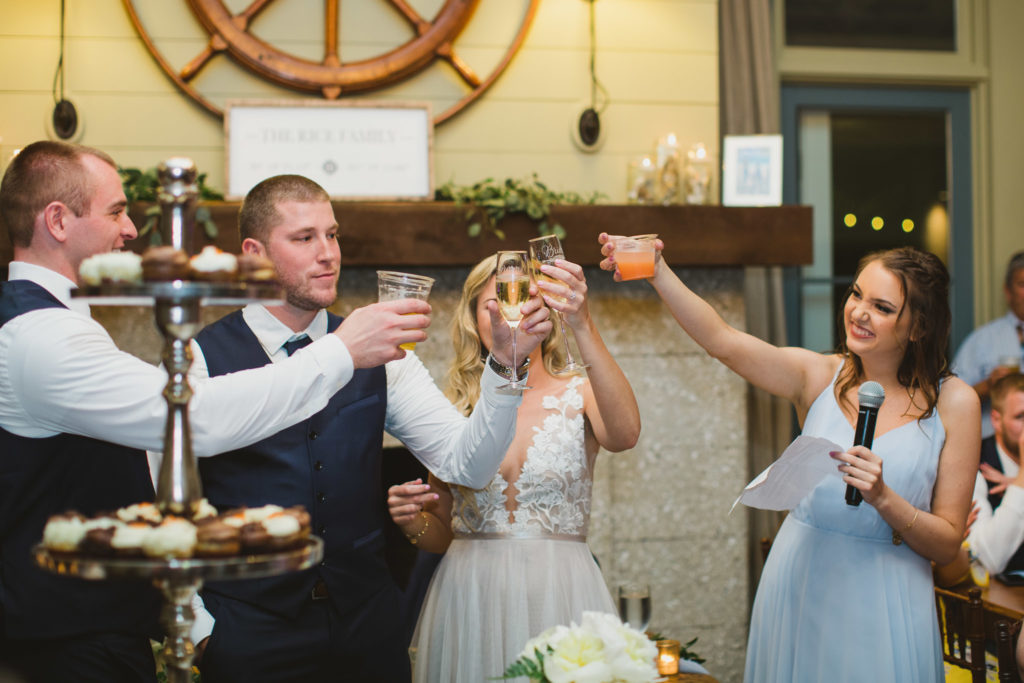 toasts during speeches at wedding reception