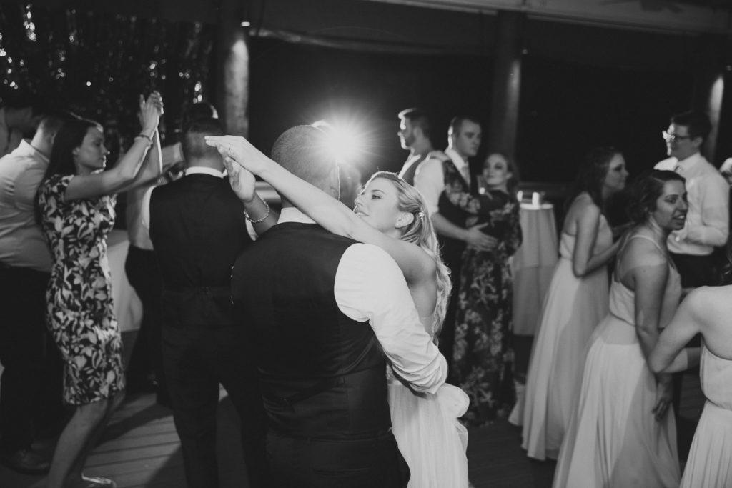 bride hugging groom on dance floor