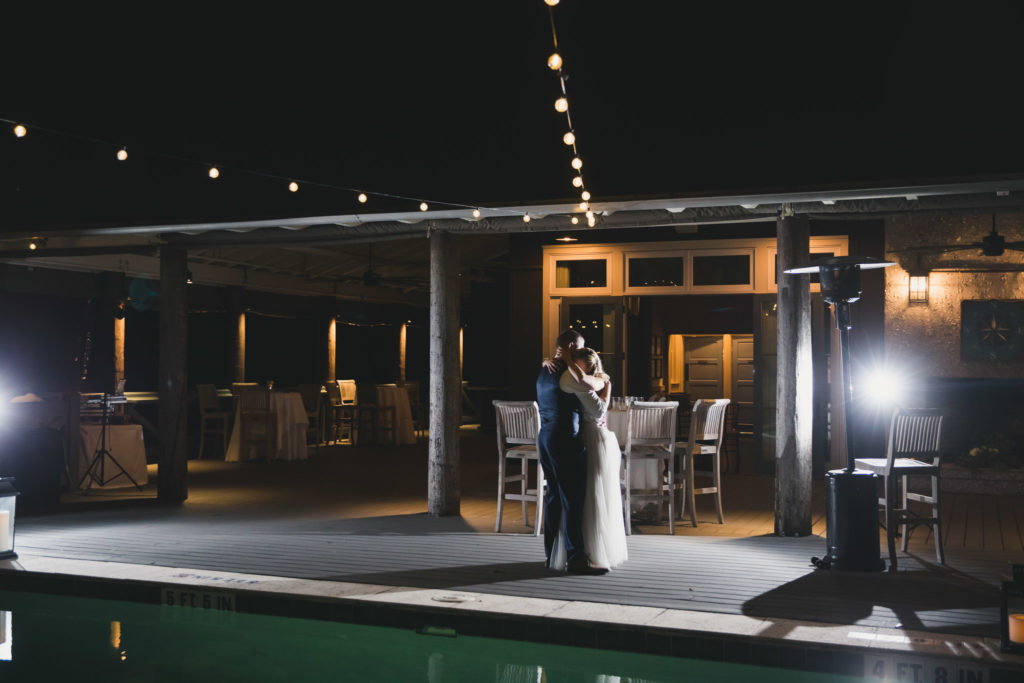 bride and groom last dance by pool at oyster bay