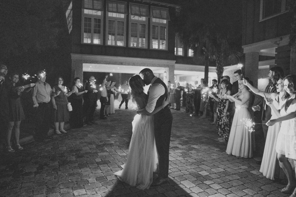 bride and groom kissing during sparkler exit outside of oyster bay yacht club