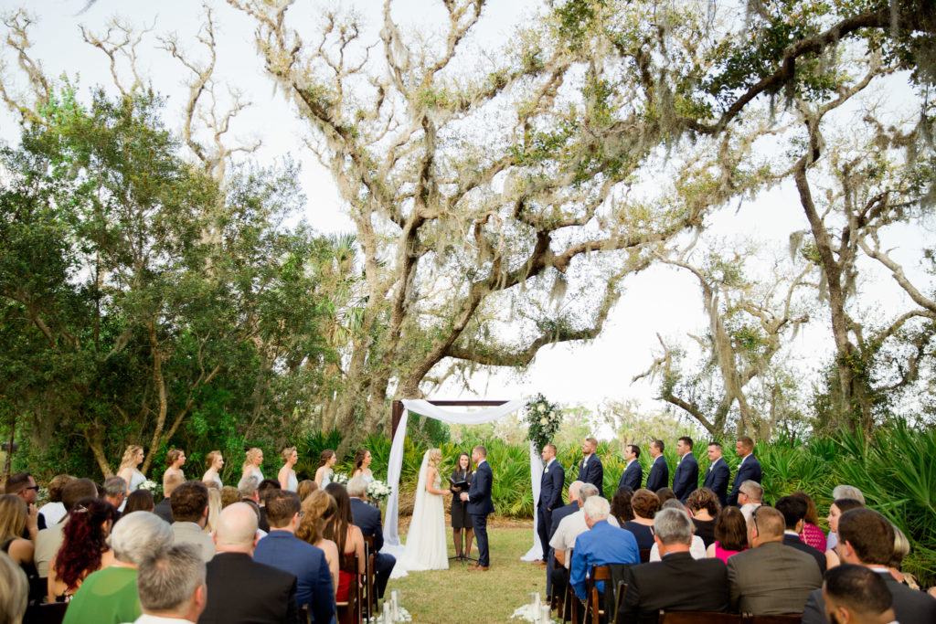 outdoors wedding ceremony on oyster bay yacht club lawn