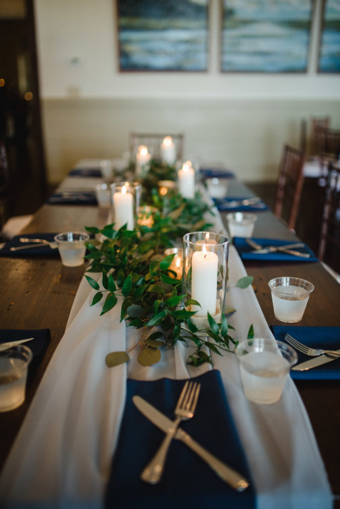 candles and greenery table centerpiece
